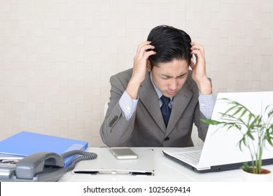 Frustrated Asian businessman.
