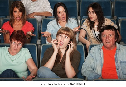Frustrated audience with rude woman on phone