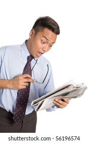 Frustrated businessman after reading the falling stock market in the newspaper