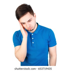 Frustrated businessman with a headache - isolated over white. Terrible headache. Frustrated young man touching his head with hands.
