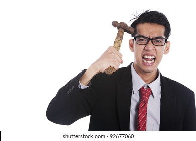 Frustrated businessman hitting his head with hammer on white background