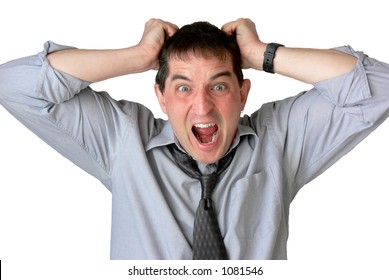 Frustrated businessman, with sleeves rolled up and tie loosened, screaming and pulling his hair.