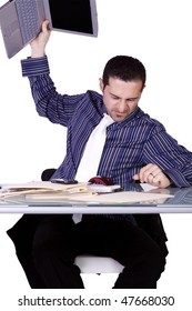 Frustrated Businessman Throwing His Laptop to the Table - Isolated Background