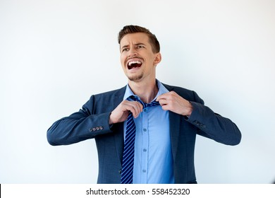 Frustrated businessman untying tie and shouting