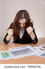 Frustrated businesswoman with financial report at office