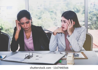 The frustrated businesswoman sat sadly with life problems and stressed her facial expressions by having her friend sit beside them with sympathy.