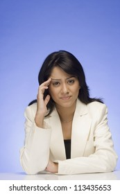 Frustrated businesswoman thinking
