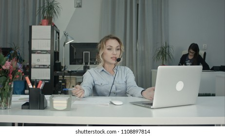 Frustrated call center woman talking with the customer