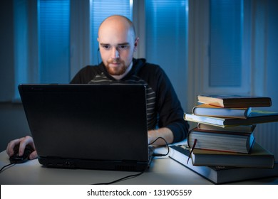 frustrated college student studying poorly at late evening,  playing a video games insead of studying,night before exam, funny night procrastination concept