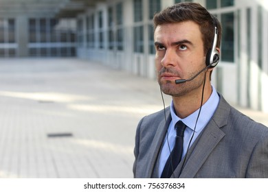 Frustrated customer service worker rolling his eyes