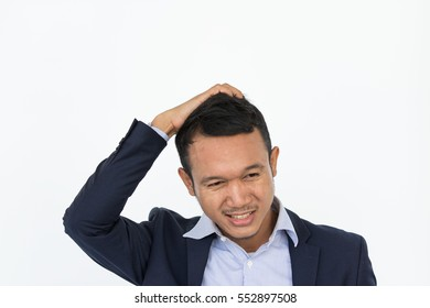 The frustrated expression : Young businessman scratch his hair to control his motion that feeling frustration, angry and mad