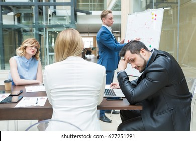 Frustrated and fatigue businesspeople sitting at the desk in office during business meeting. Office life, stress and problem concept