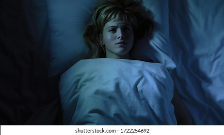 Frustrated girl cant falling asleep, thinking about her loneliness and breakup