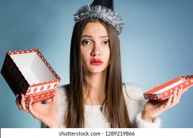 frustrated girl holding in her hand an empty gift box