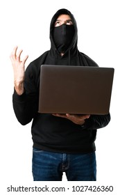 Frustrated hacker with his computer on isolated white background