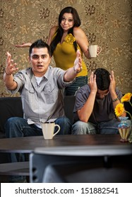 Frustrated Latino family indoors in front of television together