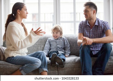 Frustrated little boy son scared with mom and dad fighting at home, sad stressed child suffers from parents argument or divorce causing mental psychological trauma, family conflicts hurt kid concept