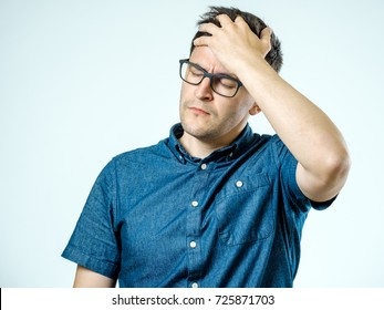 Frustrated man with headache isolated over gray background