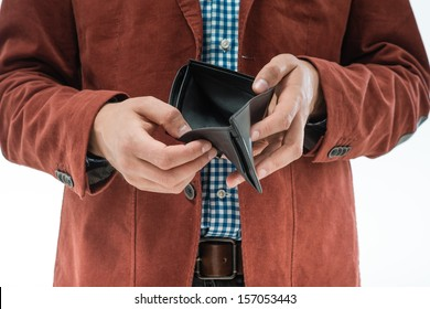 frustrated man holding an empty wallet in the hands