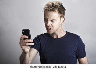 Frustrated man on smartphone