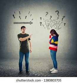 Frustrated man pointing index finger showing to someone. Dissatisfied male forefinger gesture and a worried woman introvert holding hand to forehead. Stressed girl introvert feeling guilty.