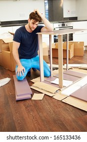 Frustrated Man Putting Together Self Assembly Furniture