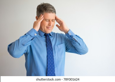 Frustrated Middle Aged Executive with Headache