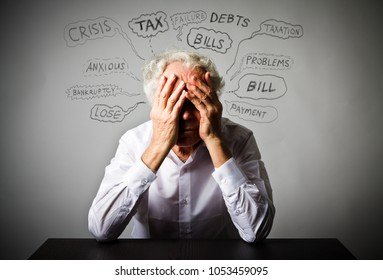 Frustrated old man in white. Taxes, debts and other problems.