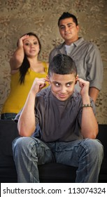Frustrated parents and child with ears plugged