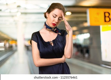 Frustrated pretty stewardess inside the airport