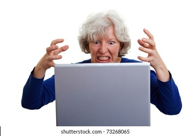 Frustrated senior woman screaming at her laptop
