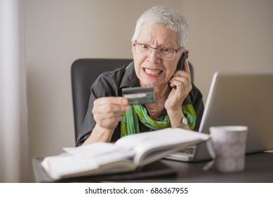 Frustrated senior woman yelling at the bank clerk, dissatisfied