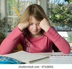 Frustrated student making a face while doing math homework