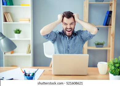 Frustrated  tired man  with laptop having a lot of work and screaming