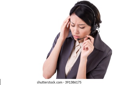 frustrated, upset business woman suffers from headache