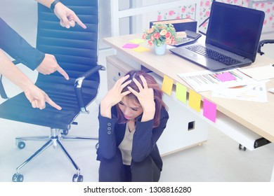 Frustrated upset young Asian business woman with fingers pointing at her in workplace of office.