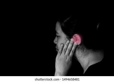 Frustrated woman having painful headache, covering closed ears, annoyed by loud noise not wanting to hear their side of story, tinnitus concept