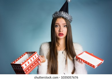 frustrated woman holding an empty box from under the gift