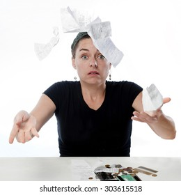 Frustrated woman looking worried about her finances and throwing all her receipts in the air.
