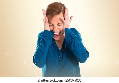 frustrated woman over ocher background