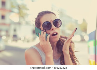 Frustrated woman talking on phone