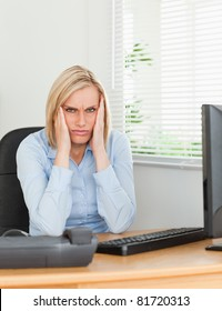 Frustrated working woman looking into camera in an office