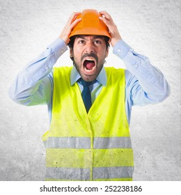 frustrated workman over textured background
