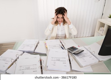 Frustrated Young Accountant Overloaded With Work In Office