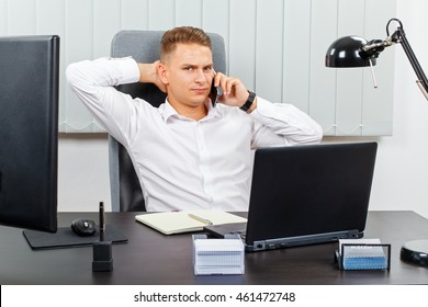 Frustrated young businessman receiving an unpleasant  phone call