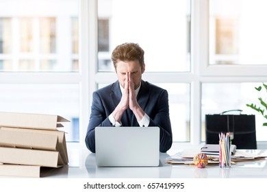Frustrated young employee is working wearily