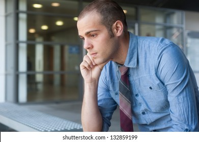 Frustrated young, handsome businessman at office