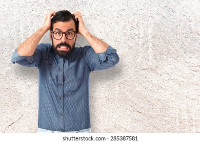 frustrated Young hipster man over textured background