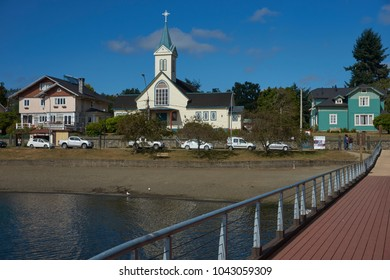 Frutillar, Los Lagos Region, Chile - January 24, 2018: Historic wooden buildings lining the waterfront of Frutillar on the shore of Lake Llanquihue in the Lake District of southern Chile.