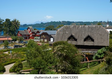 Frutillar, Los Largos, Chile - January 24, 2018:  Traditional wooden farm buildings set in the landscaped gardens of the German Colonial Museum in Frutillar in the Lake District of southern Chile.